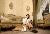 Attractive woman with the dog — Стоковое фото