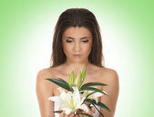 Young lovely woman with lily flower — Stock Photo