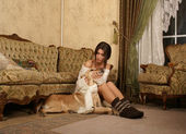 Attractive woman with the dog — Stock Photo