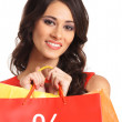 Beautiful woman with some shopping bags — Stock Photo #21487493