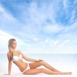 Young attractive woman in swimsuit isolated on white — Stock Photo #21488315