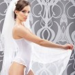 Young sexy bride in erotic lingerie — Stock Photo