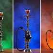 Different hookahs over the bright backgrounds with smoke — Stock Photo #21488593
