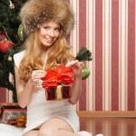 Beautiful teenager girl and the Christmas tree — Stock Photo #21488783