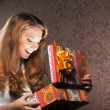 Young teenage girl opening the present — Stock Photo #21488845