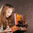Royalty-Free Stock Photo: Young teenage girl opening the present