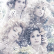 Stock Photo: Fashion shoot of young beautiful nymphs in the abstract winter forest