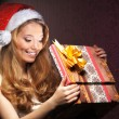 Young teenage girl opening the present — Stock Photo #21489727