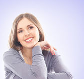 Young and beautiful woman on the sofa — Stock Photo