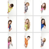 Set of teenagers with a giant, blank, white billboard — Stok fotoğraf