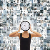 Young woman with the watches over the abstract business collage — Stock Photo