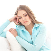 Young woman suffering of the pain over white background — Stock Photo