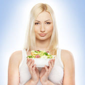 Young attractive girl with fresh and tasty salad — Stock Photo