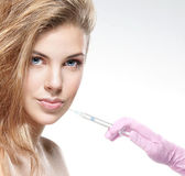 Beautiful woman gets an injection in her face — Stock Photo
