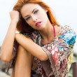 Portrait of young and beautiful redhead woman - Stock Photo