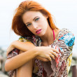 Portrait of young and beautiful redhead woman - Stok fotoraf