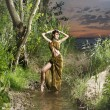 Young, beautyful and sexy savage girl in jungle - Photo