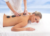 Young attractive woman getting spa treatment over white backgrou — Stock Photo