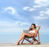 Young, beautiful, sporty and sexy woman with the notebook pc rel — Stock Photo