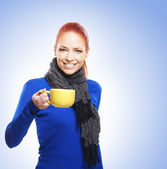 Young attractive woman drinking tea — Stock Photo