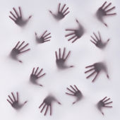 Frightening silhouette of many different hands — Stock Photo
