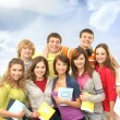 Group of smiling teenagers staying together and looking at camer - Stock Photo