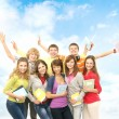 Group of smiling teenagers staying together and looking at camer — Stock Photo #23995775
