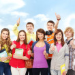 Group of smiling teenagers staying together and looking at camer - Foto Stock