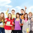 Group of smiling teenagers staying together and looking at camer — Stock Photo #23995865