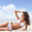 Young, beautiful, sporty and sexy woman relaxing on the beach — Stock Photo #23995973