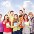 Group of smiling teenagers staying together and looking at camer — Stock Photo #23996129