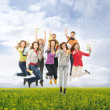 Group of smiling teenagers jumping together  — Stok fotoğraf