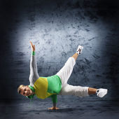 A young and fit dancer in modern clothes performing — Stock Photo