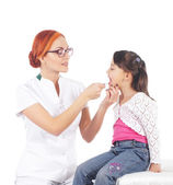 Attractive young doctor and the little girl isolated on white — Stock Photo