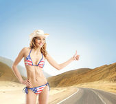 Young, slim, healthy and beautiful woman in swimsuit over the wh — Stock Photo