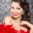 Stock Photo: Cabaret artist in red boa over the vintage background