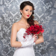Young and beautiful bride standing with the flower bouquet — Stockfoto