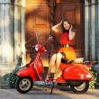 Vintage image of young attractive girl and old scooter — Stock Photo