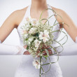 Beautiful wedding bouquet in bride's hands - Stock Photo