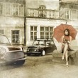 Vintage image of young attractive girl with two old cars — ストック写真