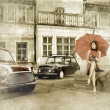 Vintage image of young attractive girl with two old cars — Stock Photo