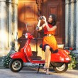 Vintage image of young attractive girl and old scooter — Stockfoto