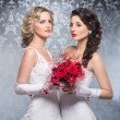Stock Photo: Young, beautiful and emotional brides with beautiful flowers o