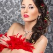 Cabaret artist in red boa over the vintage background — Stock Photo #25309631