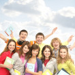 Group of smiling teenagers staying together - Foto Stock