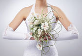 Beautiful wedding bouquet in bride's hands — Stock Photo