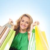 Aantrekkelijke vrouw doen winkelen geïsoleerd op wit — Stockfoto