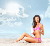 Young, beautiful, slim and sexy woman on the beach — Stock Photo