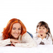 A happy mother and a young daughter on a light background — Stock Photo #25310057