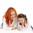 A happy mother and a young daughter on a light background — Stock Photo